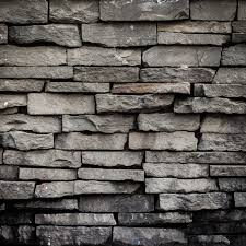 old black brick wall background and texture premium photo