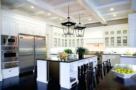 kitchen white cabinets black granite stainless steel mount range hood dark wood floors with white cabinets