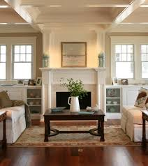 wall with built in bookcases under windows on either side of fireplace from asher