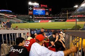 Watch fans flee as Padres-Nats game ...