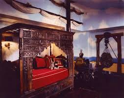 while this room has an elaborate pirate theme it also contains an exotic intricately carved covered bed that appeals to all ages