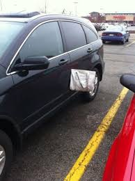 designer purse stuck in a car door funny pictures hilarious jokes meme humor walmart fails