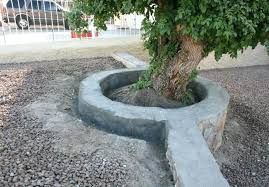 quikrete bag retaining wall rocks moved to work on rock wall around tree rock wall repaired inside tree circle and outside short section how to build a