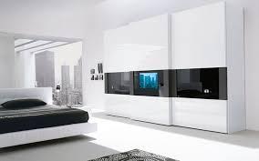 Super Modern Bedroom Wardrobe With A TV Built In The Door | DigsDigs