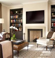 innovative living room with over fireplace and tv design ideas