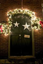 Decorating a country primitive door for Christmas.