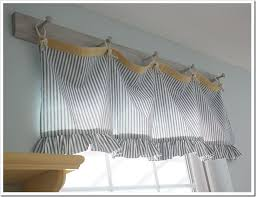 Love this valance and how it was hung on a peg rack.or could be hung on  twine with clothes pins.Great for my vintage laundry room.