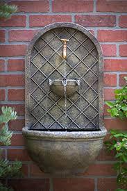 the milano outdoor wall fountain floine stone finish
