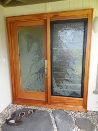 this project involved a collaborative effort from a glass artisan and m design custom etched glass of tropical foliage encased into solid mahogany wood