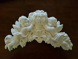 architectural ornate plaster cherub
