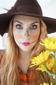 you can easily bee a super cute scarecrow with a bit of eyeliner start with a triangle of an orange eye shadow on