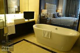 for privacy guests can use the blinds to cover the glass wall that separates the bathroom to the bedroom