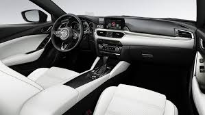 vehicle shown above left is the 2017 mazda with optional equipment