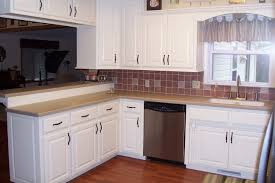 kitchen white wooden cabinet with brown counter top and sink placed on the brown wooden
