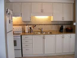 red oak wood black yardley door painting laminate kitchen cabinets backsplash herringbone tile granite limestone countertops sink faucet island lighting