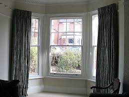french cloque work in silk interlined and pinch pleated curtains corded steel bay window track fixed