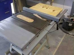 refurbished table saw with plywood side extension added