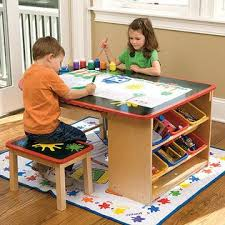 This art table would be cute in a brightly colored craft room or kids  playroom!