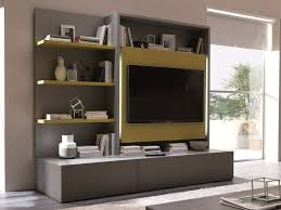 studio living room furniture. the smart living media system is a new concept on space saving design complete with television dining table folding chairs and storage studio room furniture