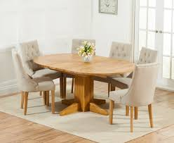 dijon 120cm solid oak round extending dining table with prague fabric chairs