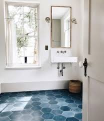 blue hex tiles with white grout on the floor