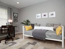 small guest room office ideas. this serene home office features a comfortable day bed for guests the bedding is mix of soft white and gray with yellow accents which compliment small guest room ideas