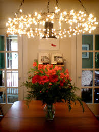 DIY: Wreath Frame Chandelier Tutorial - 2 wreaths, Christmas lights, chain  & an extension cord.-This would be pretty hanging on a screened porch for  ...