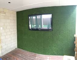 artificial turf can transform a boring brick or old wall in to a beautiful feature this can be used indoors or outside