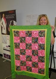 13 best PFAFF® Quilts for Kids - Charity Event images on Pinterest ... & Mindy Davy shows off one of the completed quilts. Adamdwight.com