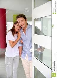 opening front door. Happy Couple Opening House Front Door Stock Image - Of Standing, Estate: 30598269 S