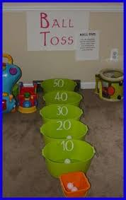 ball toss game. cut a paper towel roll into several pieces to make your course, and use tooth picks for flags. buttons as golf balls, you are ball toss game