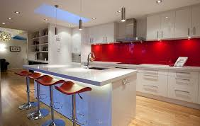 View in gallery Glossy back-painted glass backsplashes in red are both  popular and trendy