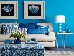 living room blue wall with pictures and white wooden square table having white blue lamp