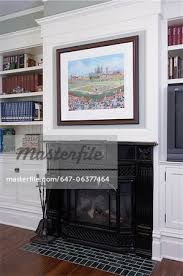 fireplaces red victorian black cast iron mantel and firebox framed with white wood trim built in shelving on either side framed art
