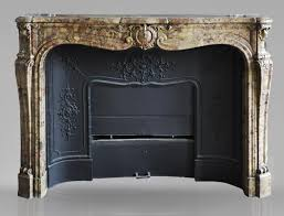 beautiful antique louis xv period fireplace in breche d alep marble decorated with a cartouche and a cast iron insert