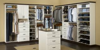 wooden closet organizer system in white with shoe stand and drawers