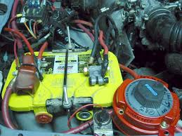 electricalsystem located in engine compartment this is one of two auxiliary batteries this battery powers the front winch and off road lights among other accessories is