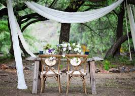 rustic wood sweetheart table and chairs with mr and mrs wood signs