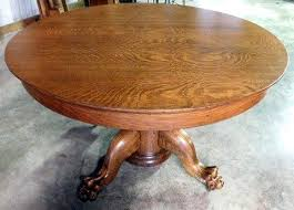 48 round tiger oak dining table with nice pedestal large carved claw feet 3 8 leaves extends to 72
