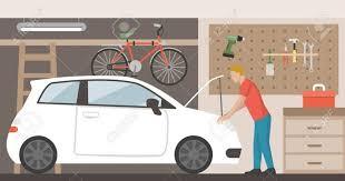 man repairing his car
