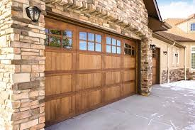 Image Clopay Wood Garage Doors Look Great With Homes That Have Stone Exteriors Just Like Our Model 7103 Mustang With Custom Stained Finish And 24lite Arched Windows On Wayne Dalton Garage Doors 10 Beautiful Custom Wooden Garage Door Designs