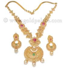 set with ruby emerald pearl and uncut diamonds 22 kt gold gold palace jewelers inc