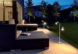 outdoor gazebo with sectional couch and standing lighting lamp