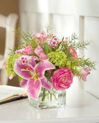 exotic pink rubrum lilies ranunculus wax flower and green viburnum silk arrangement in vase