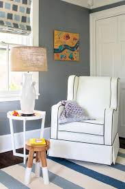 black and white wingback nursery rocker with blue striped rug