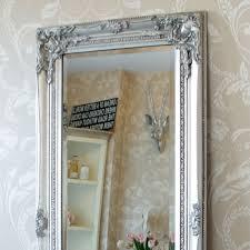 tall silver ornate mirror