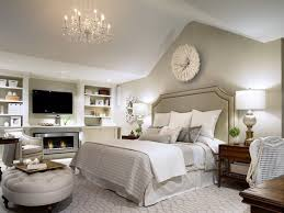 classic bedroom decorating ideas. white on bedroom by candice olson. love the built-ins with tv and fireplace. classic decorating ideas