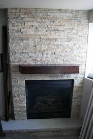 Stacked Stone Fireplace modern-basement