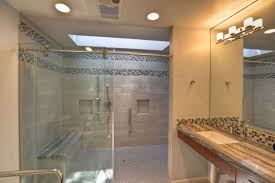 shown is a frameless glass shower enclosure with clear glass photo courtesy of a