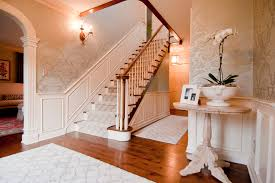dazzling nourison rugs in entry traditional with carpet runners next to wallpaper wainscoting alongside foyer wainscoting and dark wood stairs
